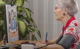 a person using online telehealth via computer
