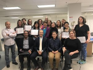Photo of class of Fall 2018 holding certificates with Poney Chiang