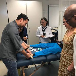 Instructor Ryan Tze-Wai Longenecker teaches participants on lower extremity conditions